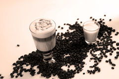 Coffee cocktail with coffee beans and milk Royalty Free Stock Images