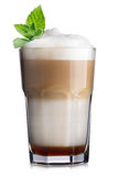Coffee cocktail. Glass of coffee cocktail with chocolate syrup and foam decorated with min leaves Stock Image