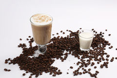 Coffee cocktail. A glass of coffee cocktail  and a small glass of milk Stock Photo