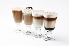 Coffee cocktails. Four coffee cocktails with whipped cream stock image