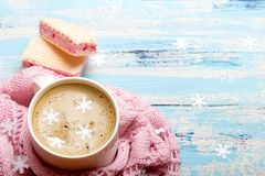 Coffee or cocoa and sweet cookies on blue wooden background. Tasty Christmas coffee or cocoa and sweet cookies on blue wooden background and pink tablecloth Stock Image