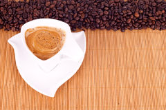 Coffee and coffee beams. Cup of instant coffee and coffee beams with space for text Royalty Free Stock Photography