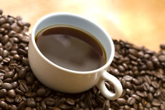 Coffee on coffee bean Royalty Free Stock Image