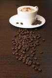 Coffee and coffee beans. On table Stock Image
