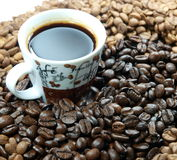Coffee and coffee beans. Cup with coffee full of beans royalty free stock photo
