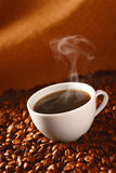 Coffee on coffee-beans Royalty Free Stock Photo