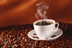 Coffee on coffee-beans Royalty Free Stock Image
