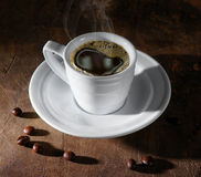 Coffee, coffee beans. Coffee cup and coffee beans on dark background royalty free stock image