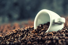 Coffee. Coffee beans. Coffee cup full of coffee beans. Toned image.  Stock Images