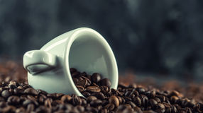 Coffee. Coffee beans. Coffee cup full of coffee beans. Toned image.  Royalty Free Stock Image