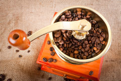 Of coffee. coffee beans and coffee grinder. Many coffee beans are next to a coffee grinder. freshly ground coffee Royalty Free Stock Photography