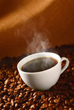 Coffee on coffee-beans 3 Royalty Free Stock Images