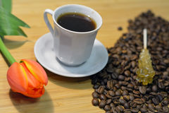 Coffee, coffee beans, fresh flower and sugar stick Stock Photo