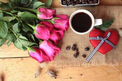 Coffee with coffee beans and red hearts. Royalty Free Stock Photo