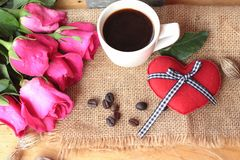 Coffee with coffee beans and red hearts. Stock Photos