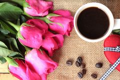 Coffee with coffee beans and red hearts. Stock Photo