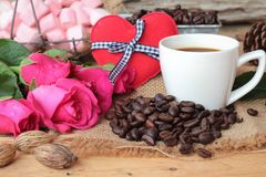 Coffee with coffee beans and red hearts. Stock Image