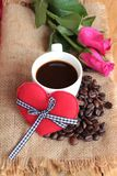 Coffee with coffee beans and red hearts. Stock Photography