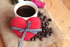 Coffee with coffee beans and red hearts. Stock Images