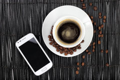 Coffee with coffee beans and smartphone Stock Photography
