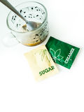 Coffee, coffee cup, Creamer sachets, sugar packets for breakfast Stock Images