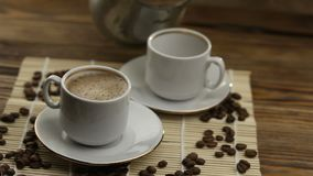 Coffee in cup with natural grains. Coffee in coffee cup with natural grains stock video footage