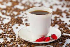 Coffee in coffee cup with natural grains Royalty Free Stock Images