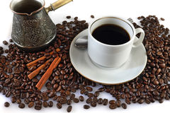Coffee and coffee grains. Still life with a cup of coffee, coffee grains and cinnamon Stock Photo