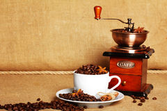 Coffee and coffee grinder. Coffee and retro coffee grinder Royalty Free Stock Images