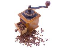 Coffee and coffee grinder. Coffee grinder and scattered grains of coffee Stock Photos