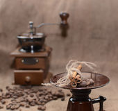 Coffee in a coffee grinder. On sacking Royalty Free Stock Photo