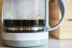 Coffee in the coffee maker. Strong and aromatic black coffee, freshly brewed in the coffee maker Stock Photo