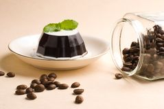 Coffee, coffee pudding and coffee beans Stock Images