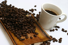 Coffee and coffee seeds. Hot coffee with coffee seeds Royalty Free Stock Images