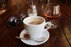 Coffee with cognac in a cafe Stock Photos