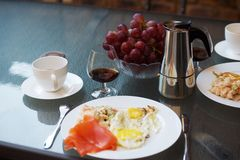 Coffee, cognac and scrambled eggs breakfast Stock Photos