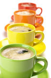 Coffee in colorful cups Stock Images