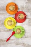Coffee in colorful cups Stock Photos