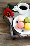 Coffee and colorful macaroon on a tray Royalty Free Stock Image