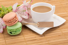 Coffee and colorful macaroons Stock Photos