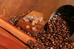 Coffee composition. With brown sugar on a wooden table Stock Photo