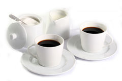 Coffee composition. Two cups of coffee with milk and sugar on the table Stock Images