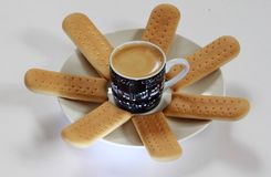 Coffee composition. Cookies in form of the sun around a Cup of coffee stock photo