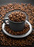 Coffee composition of grain and cup Stock Photography