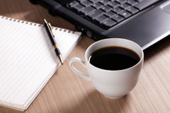 Coffee and computer - break in office Stock Photography