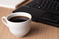 Coffee and computer - break in office Stock Images