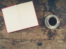 Coffee concept with cup and book Stock Photos