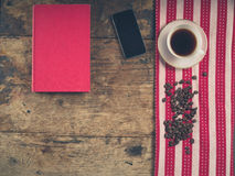 Coffee concept with cup, a book and a smart phone Stock Photos