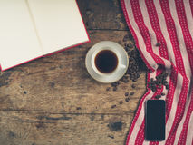 Coffee concept with cup, a book and a smart phone Royalty Free Stock Photos