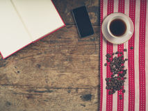 Coffee concept with cup, a book and a smart phone Stock Photography
